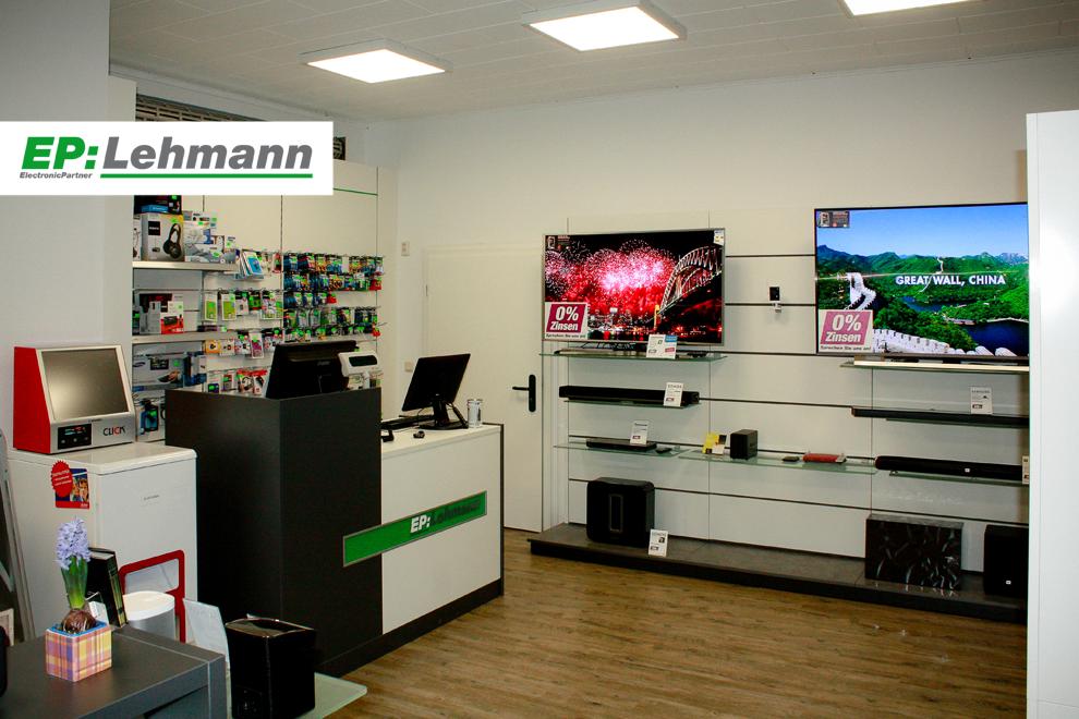 Kassenbereich mit Fotosofortdruckautomat bei EP: Lehmann in Nauen